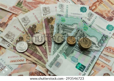 A lot of money, rubles, dollars, euros, and coins of gold and silver. Money is a symbol of government, business, good luck. - stock photo