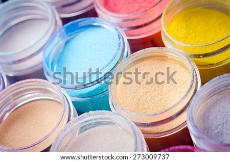 a lot of multicolored paint in jars for makeup artistry - stock photo