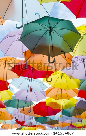 A lot of multicolored umbrellas over the sky - stock photo