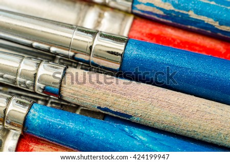 a lot of paintbrushes as a background - stock photo