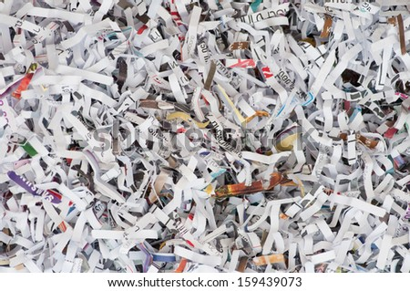 a lot of paper stripe inside the paper shredder - stock photo