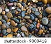 A lot of pebbles as background - stock photo