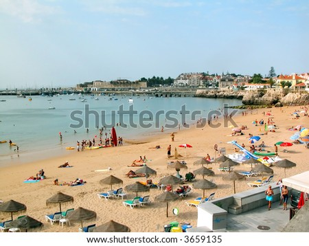 A lot of people on sandy beach in Portugal. - stock photo