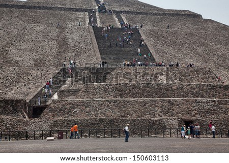 A lot of people on the pyramid of Teotihuacan - stock photo