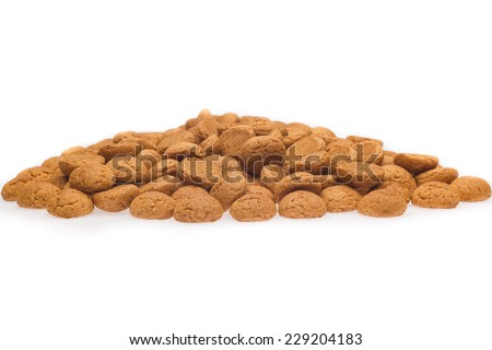 A lot of pepernoten, traditional dutch treat for Sinterklaas event on 5 December. Isolated on white background. Front view. - stock photo