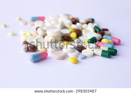 A lot of pills on the white background. Medicine - stock photo