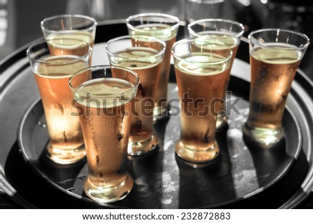 A lot of pints of Beer on black tray - stock photo