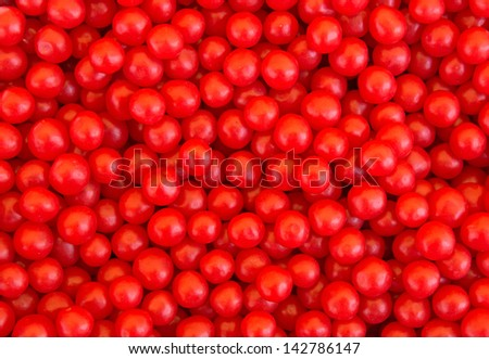 A lot of red candies for background  - stock photo