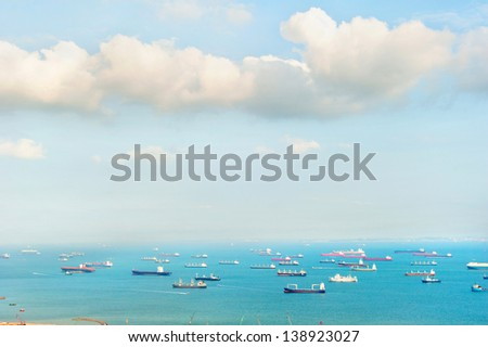 A lot of ships in the Singapore harbor - stock photo