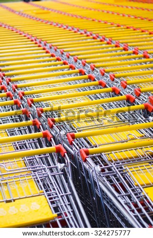 A lot of shopping carts stacked together in rows - stock photo