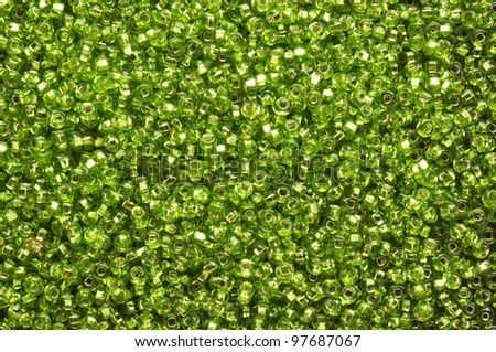 a  lot of small green beads on plane - stock photo