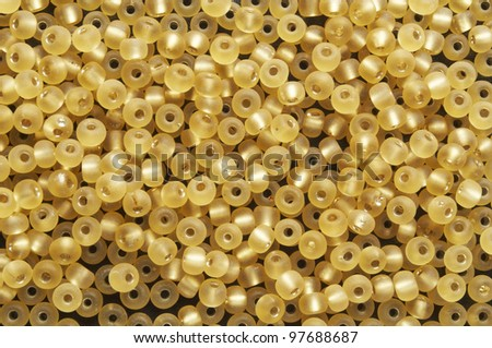 a  lot of small yellow  beads on plane - stock photo