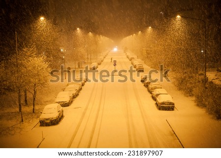 a lot of snowfall and empty road - stock photo
