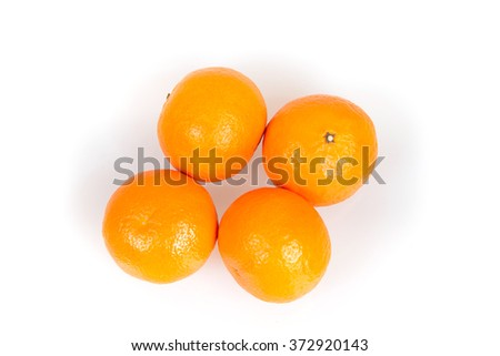 A lot of tangerines on a white background, juicy, ripe tangerines, orange mood - stock photo