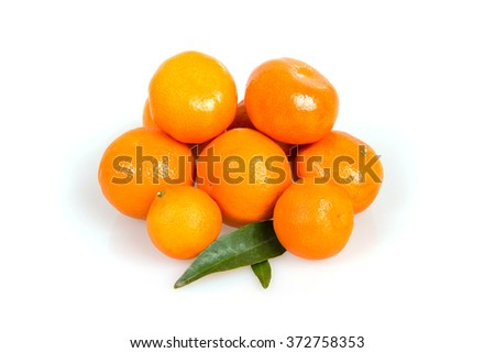 A lot of tangerines on a white background, juicy, ripe tangerines, orange mood, fruit rich in vitamins - stock photo