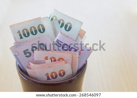 A lot of thai money in jar - stock photo