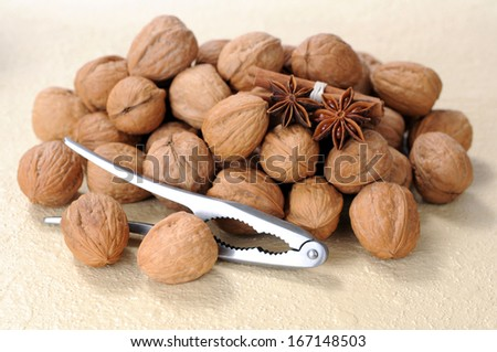 a lot of walnut, star anise, cinnamon and cracker on table  - stock photo