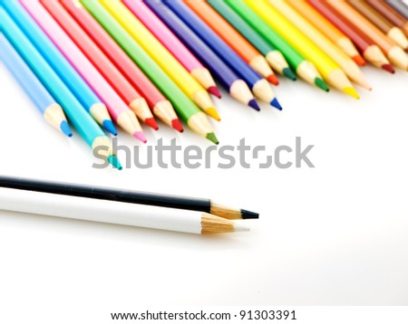 A lot of wooden pencils on a light background. Unique and leadership concept - stock photo