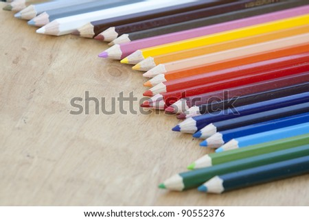 A lot of wooden pencils on wood - stock photo