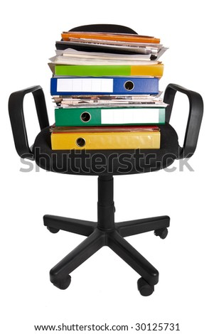 A lot of work - office chair with folders and papers - stock photo
