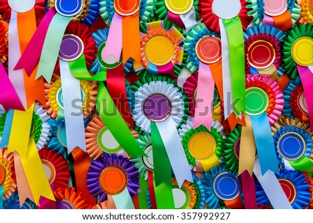 A lots of ribbons rosettes overlapping background photography   - stock photo
