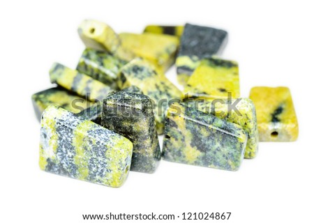 A lovely pile of yellow turquoise beads, a natural mix of quartz, jasper and serpentine. - stock photo