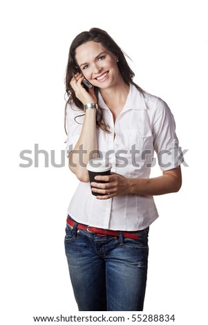 A lovely portrait of a casual beautiful woman talking on the phone and holding a take away coffee. Isolated over white. - stock photo