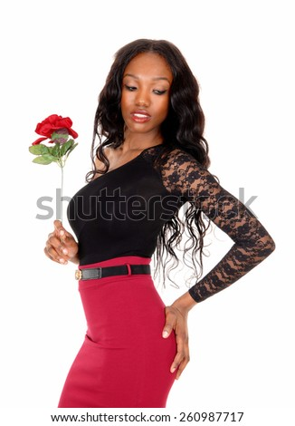 A lovely slim African American woman in a red skirt and black blouse