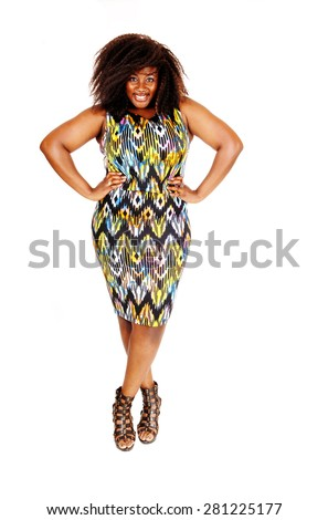 A lovely smiling African American woman standing in a colourful dressisolated foe white background. - stock photo