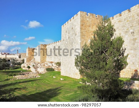 A lovely sunny day in Jerusalem. The walls and towers against the sky and clouds - stock photo
