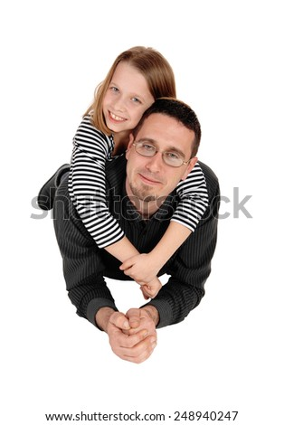 A lovely young girl lying on the back of her daddy, isolated for white background.  - stock photo
