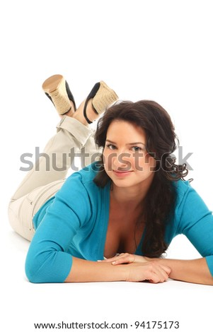 A lovely young woman lying on the floor, isolated on white background - stock photo
