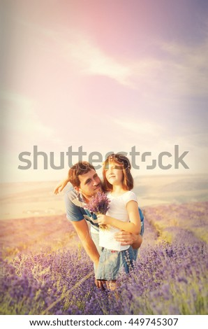 A loving father and cute little girl in a lavender field - stock photo