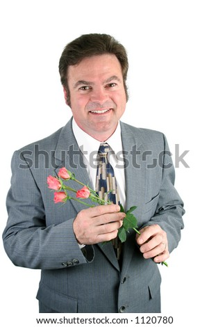 A loving husband holding roses for his sweet-heart. - stock photo