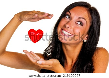 a loving young woman holds a heart in his hand - stock photo
