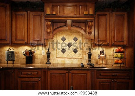 A low light photo of a warm beautiful kitchen - stock photo