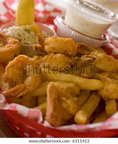 A lunch of fried shrimp and potatoes - stock photo