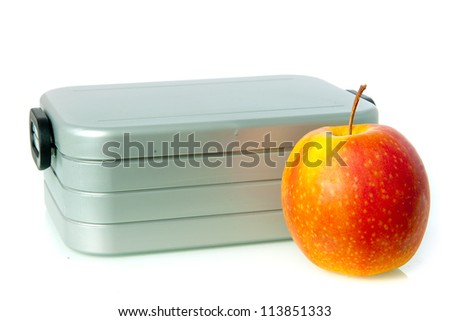 a lunchbox, with an apple on a white background - stock photo