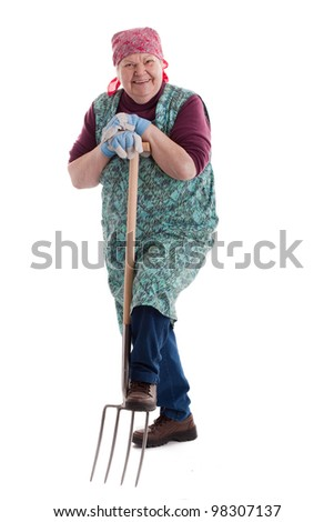 A lusty female senior with pitchfork  looks to viewer 3 - stock photo