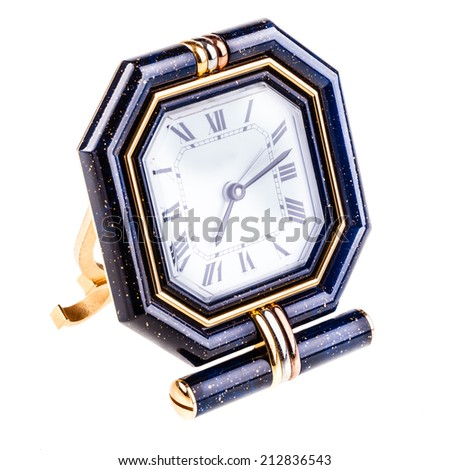 a luxurious table clock isolated over a white background - stock photo