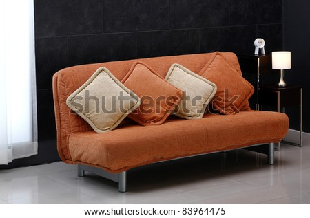 A luxury comfortable sofa bed and cute cushions - stock photo