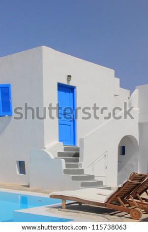 A luxury swimming pool  on the greek island of santorini - stock photo