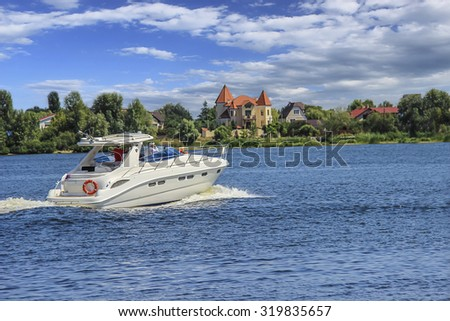A luxury yacht moving through calm water - stock photo