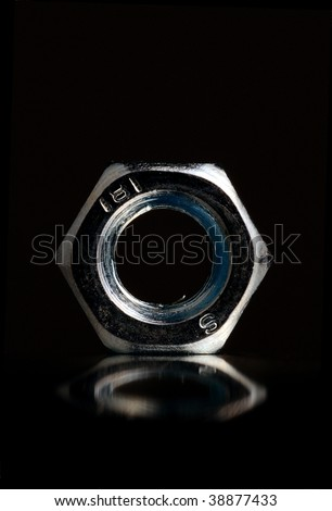 A macro of bolt with black foreground - stock photo