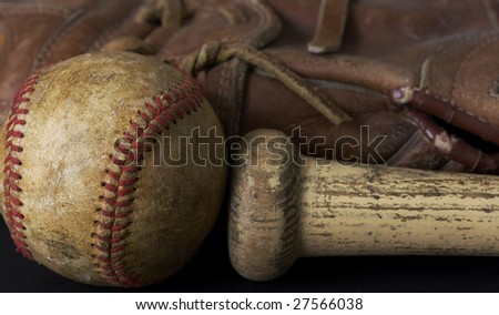 a macro picture of a baseball, glove, and bat - stock photo