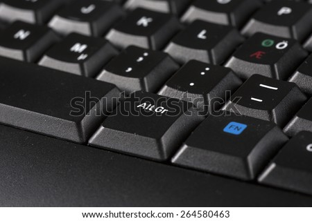 A macro shot of a black keyboard. Alt Gr button in focus. - stock photo