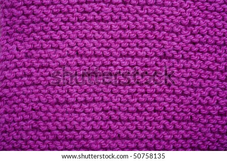 A macro shot of a bright pink knit background - stock photo