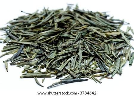 a macro shot of a dry green tea - stock photo