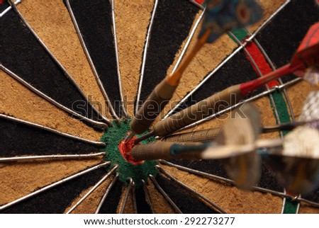 A macro shot of an old style dart board. - stock photo