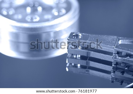 a macro shot of an open hard drive - stock photo